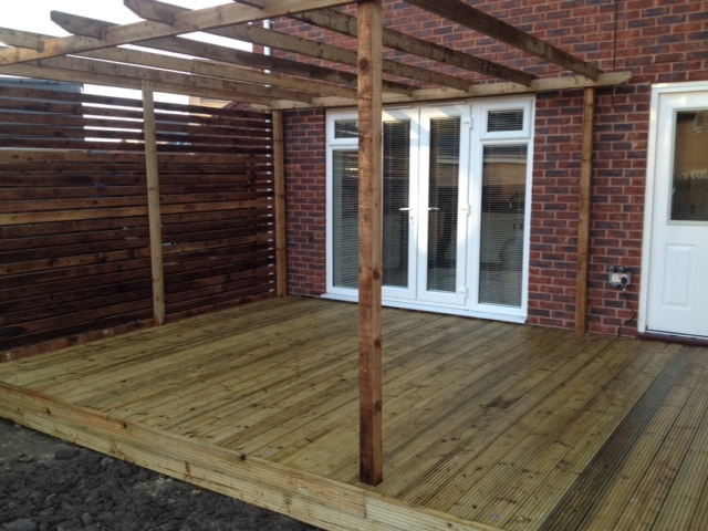Garden design gallery block paving drives patios for Tanalised decking boards